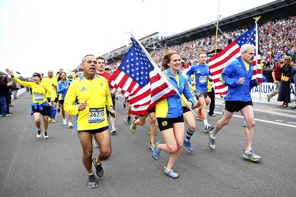 Participants who did not finish the Boston Marathon run Sunday before the Indianpolis 500. Twin blasts near the finish line of the marathon April 15 killed 3 people and injured more than 260.