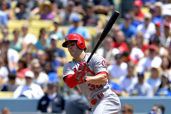 St. Louis Cardinals' Pete Kozma, left, hits a three-run double against the Dodgers.