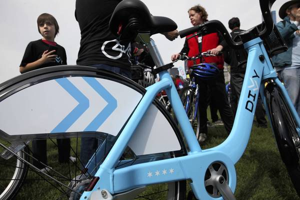 A Divvy bike, used for the ride-share program set to start in June, is on display at the finish of Sunday's Bike the Drive in Chicago.