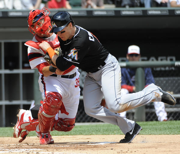 CHICAGO, IL -MAY 26: Hector Gimenez #38 of the Chicago White Sox tags out Chris Coghlan #8 of the Miami Marlins during the second inning on May 26, 2013 at U.S. Cellular Field in Chicago, Illinois. (Photo by David Banks/Getty Images) *** BESTPIX *** ORG XMIT: 163377288