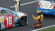 Snapped cable delays NASCAR Coca-Cola 600 at Charlotte Motor Speedway. Fans injured.