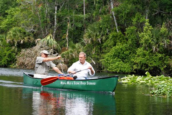 Hans Tanzler, left, director of the St. Johns River Water Management District, and Chuck Drake, a member of the agency's board, paddled down the Wekiva River in a field trip Monday, May 13, to investigate the health of the spring-fed river.