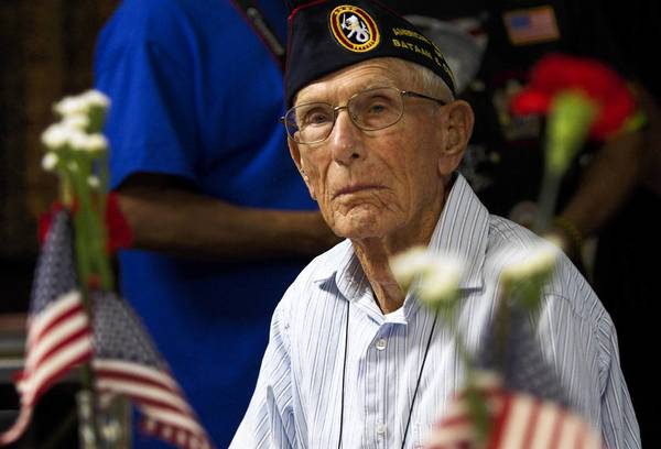 Harold Bergbower, a prisoner of war during World War II, is recognized for his service at a lunch honoring veterans at Bunny's Restaurant in Suffolk on Friday, May 24.