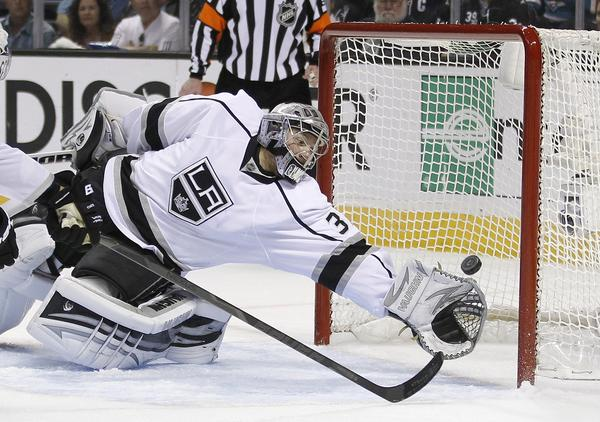 Kings goalie Jonathan Quick (32) can't stop a shot by San Jose Sharks center Joe Thornton (19) during the first period in Game 6.
