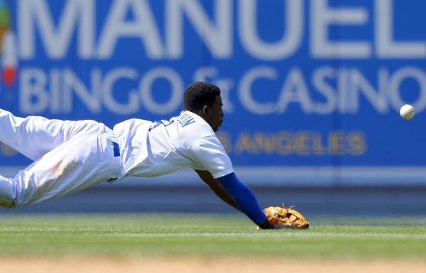 Dodgers shortstop Dee Gordon can't reach a ball hit for a double by the Cardinals' Pete Kozma during the seventh inning Sunday afternoon.