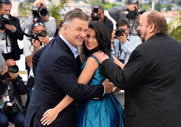 "Actor Alec Baldwin, left, his wife, Hilaria Thomas, and director James Toback during a photocall May 21, 2013, for the film ""Seduced and Abandoned"" at the 66th edition of the Cannes Film Festival in Cannes."