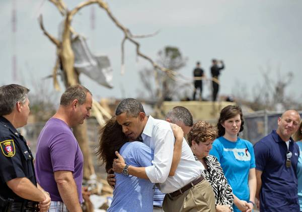 President Obama hugs a school official as he visits Plaza Towers Elementary School in Moore, Okla. The school was leveled in last week's tornado.