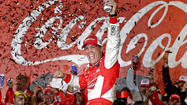 Kevin Harvick pulled away from Kasey Kahne on a restart with 11 laps left to win the Coca-Cola 600 for the second time in three seasons, a race stopped for nearly 30 minutes Sunday night when a TV camera support rope snapped.