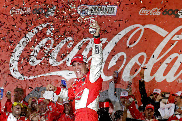Kevin Harvick celebrates in victory lane after winning the NASCAR Sprint Cup series Coca-Cola 600.