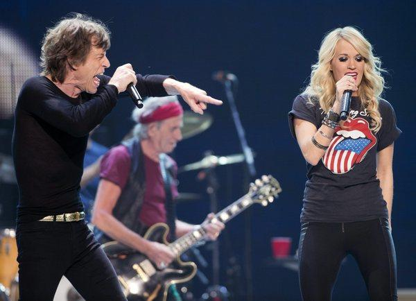 Mick Jagger performs with Carrie Underwood during the Rolling Stones concert in Toronto on May 25, 2013.