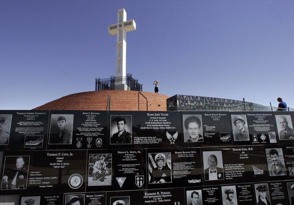 The Mt. Soledad Veterans Memorial plaques honor U.S. service personnel. The cross was built in 1954.
