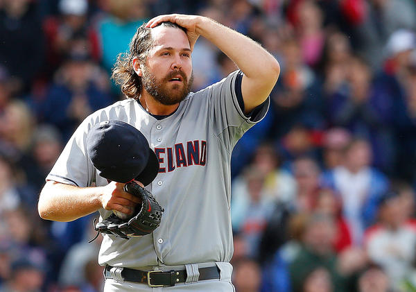 Chris Perez of the Cleveland Indians reacts with the bases loaded in the ninth inning against the Boston Red Sox at Fenway Park on Sunday.