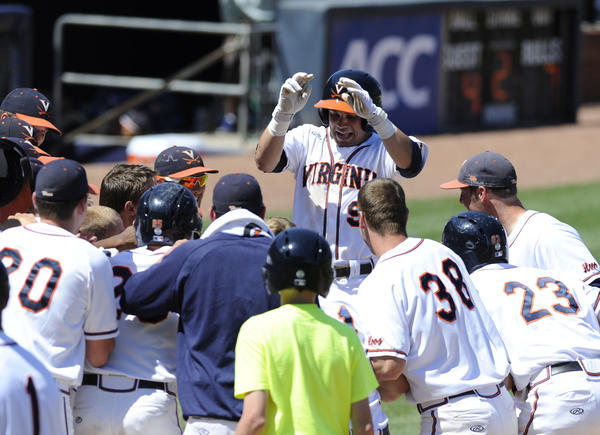 May 25, 2013; Durham, NC, USA; Virginia Cavaliers player Kenny Towns (9) celebrates with his team after hitting a home run to beat the Florida State Seminoles during the ACC baseball tournament at Durham Bulls Athletic Park. Virginia won 7-4 in 12 innings. Mandatory Credit: Liz Condo-USA TODAY Sports