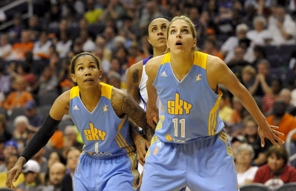 Sky forward Tamera Young (1) and guard/forward Elena Delle Donne (11) and Mercury forward Candice Dupree (4) battle for positioning Monday during a free throw attempt.