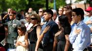 The family of fallen Army Spc. Marcos Cintron listens to Memorial Day ceremony in his honor.