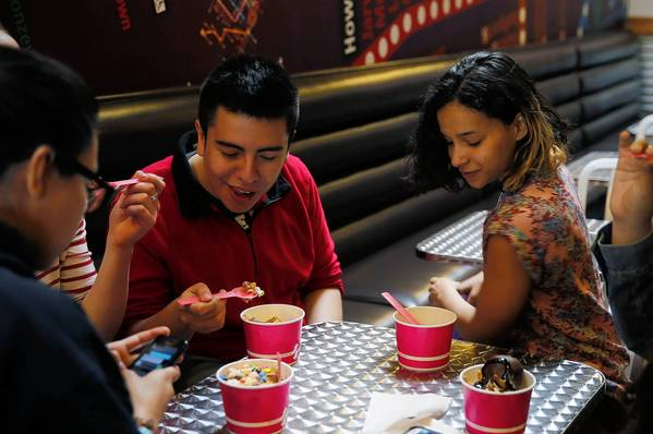 Teenagers enjoy cups of the product this month at Forever Yogurt.