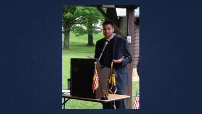 The Rev. David Bowman speaks about the importance of freedom to a group at the Shanksville Memorial Day ceremony at the Community Grove Bandstand.