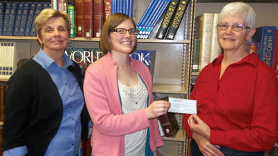 Pam Walukas (right), president of the Friends of the Library for Meyersdale Public Library, along with Penny Stahl, library board trustee, hand over an $11,170 check to Amy Hanley, librarian, to waterproof the basement this summer. This project was realized through a recent Community Foundation of the Alleghenies grant and local fundraisers.