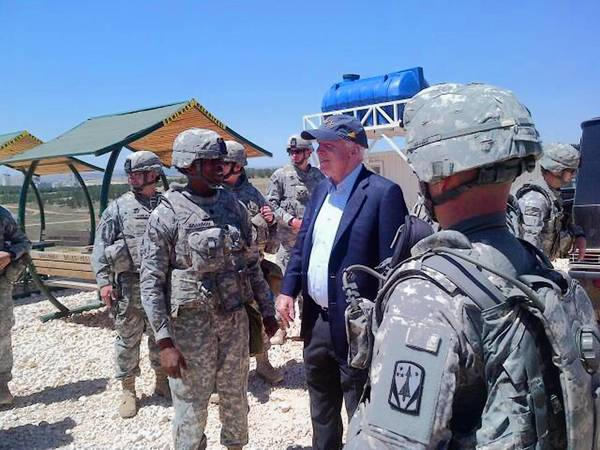 Sen. John McCain (R-Ariz.) visits troops at a Patriot missile site in southern Turkey. He also crossed into Syria for a meeting with Syrian rebels, a spokeswoman said.