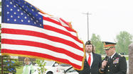 There's a simplistic and naive belief that war doesn't solve anything, Mike Herman told those who attended Monday's Memorial Day service at Sunset Memorial Gardens.