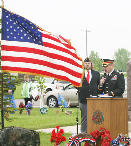 Memorial Day is not the start of summer; rather, it's a day of appreciation for veterans who died in service of the country, Mike Herman, right, of Aberdeen told those who attended the Memorial Day service at Sunset Memorial Gardens on Monday in Aberdeen. In the background is Dale Strom of Aberdeen's American Legion post.