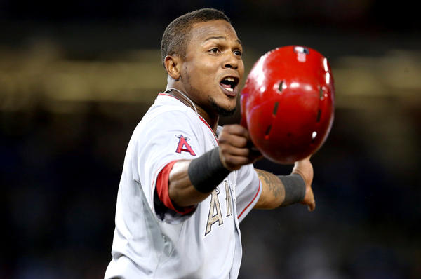 Angels' Erick Aybar argues after being tagged out in the eighth inning against the Dodgers.