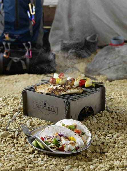 The SlatGrill weighs just 1.4 pounds in the titanium Summit style, and 2.8 pounds in the stainless steel Scout style. It comes apart to form a fold-up package of 4 inches by 9 inches, no thicker than a normal paper notebook. It can support 100 pounds of weight and utilize almost any type of fuel,