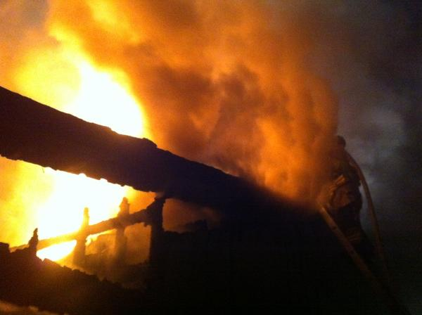 Firefighters battle a blaze on Whitford Road in Sharon Monday night.