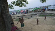 NEW DELHI -- A watchdog group Tuesday called on Myanmar's government to immediately revoke a population-control policy that blocks members of the minority Rohingya Muslim community from having more than two children, measures it said are discriminatory, violate human rights and endanger women's health.