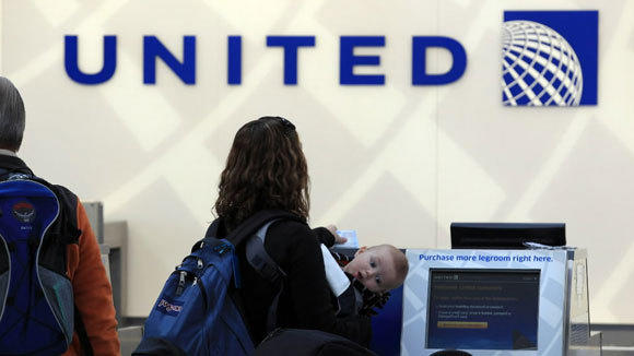 United passengers check in at O'Hare International Airport in a 2012 file photo.