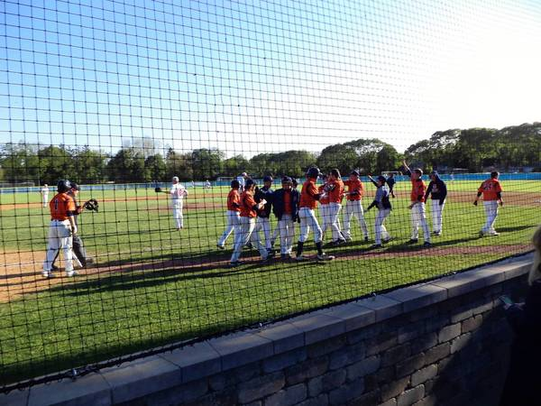Buffalo Grove celebrates after taking an 11-8 lead in the sixth inning against Mundelein.