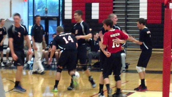 Maine South celebrates a key point against New Trier.