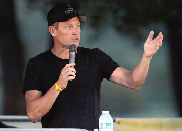 "Cyclist Lance Armstrong (L) addresses participants at The LIVESTRONG Challenge Ride as Doug Ulman (R), Livestrong President and CEO, looks on at Palmer Events Center on October 21, 2012 in Austin, Texas. More than 4,000 cyclists participated in the charity ride supporting cancer survivors. Armstrong has recently been accused of leading ""the most sophisticated, professionalized and successful doping program that sport has ever seen"" according to USADA officials."