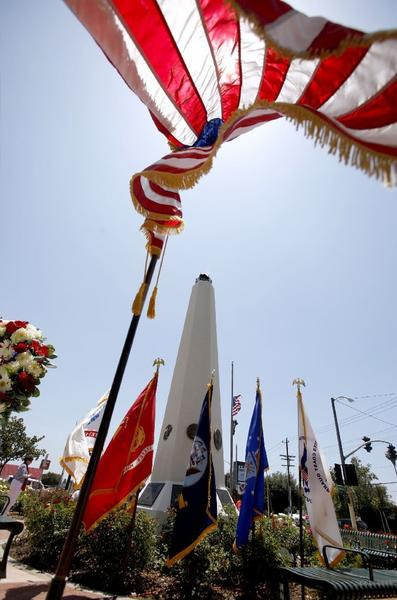 Flags wave in the wind at the annual Memorial Day Ceremony at McCambridge Park War Memorial in Burbank on Monday.