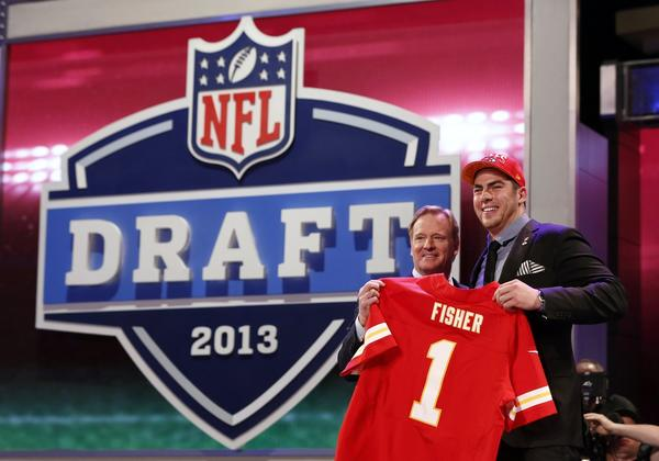 Eric Fisher stands with NFL Commissioner Roger Goodell after being selected by the Kansas City Chiefs as the first overall pick in the 2013 NFL draft.