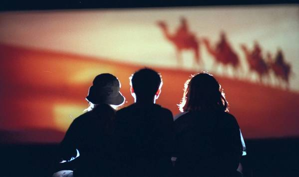 Three friends watch a film at at the Mansfield Drive-In.