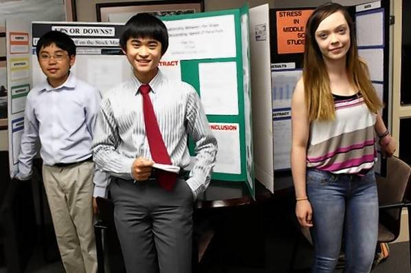 Students Josh Gonzalez, Roger Shen and Sarah Clinkunbroomer shared their science fair projects at a recent District 28 school board meeting.