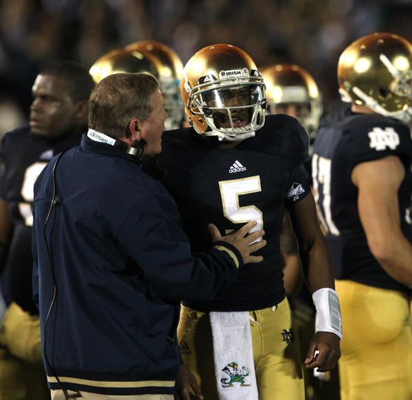 Notre Dame Fighting Irish coach Brian Kelly speaks with Notre Dame Fighting Irish quarterback Everett Golson (5) after he threw an interception in the end zone to Michigan Wolverines safety Thomas Gordon (30) during the first half of their game at Notre Dame Stadium in South Bend, Indiana, on Saturday, September 22, 2012. (Nuccio DiNuzzo/Chicago Tribune) B582391940Z.1 ....OUTSIDE TRIBUNE CO.- NO MAGS, NO SALES, NO INTERNET, NO TV, CHICAGO OUT, NO DIGITAL MANIPULATION...