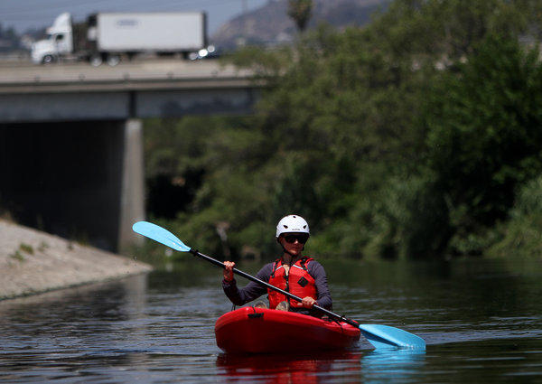 Agnieszka Pietruszkiewicz, 27, of Los Angeles, kayaks on the LA River, near Marsh Park on the Los Angeles River.