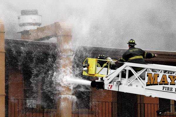 Firefighters spray water to control a five-alarm fire that destroyed the Supermercado Durango and four adjoining apartments at 1651 N. Mannheim Rd. in Stone Park.