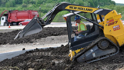Randy Tullio, CH & D Enterprises of New Stanton, moves dirt in a park and ride project off of Route 30.