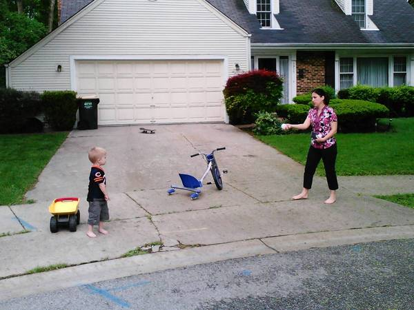 Beth Richards plays with son, 3-year-old Ryan Leland, in front of their rented home. They live at the end of the Haddow Avenue cul-de-sac, the site of Orchard Evangelical Free Church's proposed parking lot.