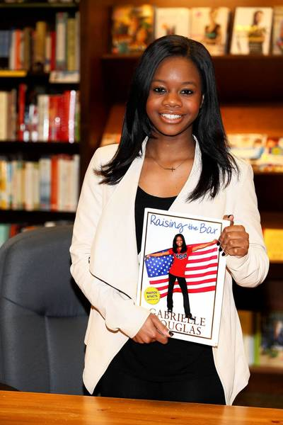 "Olympic gold medal gymnast Gabrielle Douglas at a book signing For ""Raising The Bar"" in Skokie."