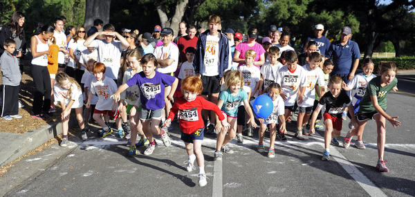 Community members participate in the Crescenta-Canada Family YMCA 1-mile family fun run, 10k run, 5k run and 5k walk at Descanso Gardens during the La Canada Fiesta Days on Memorial Day, Monday, May 27, 2013 in La Canada, Calif.