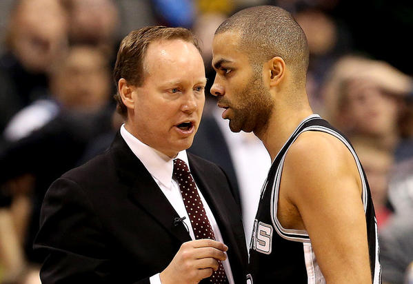 Mike Budenholzer, left, is seen with Tony Parker of the San Antonio Spurs.