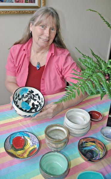 Ellissa Weekley, of Burbank, with several bowls she has made for the Family Promise Empty Bowl fundraiser on June 2.