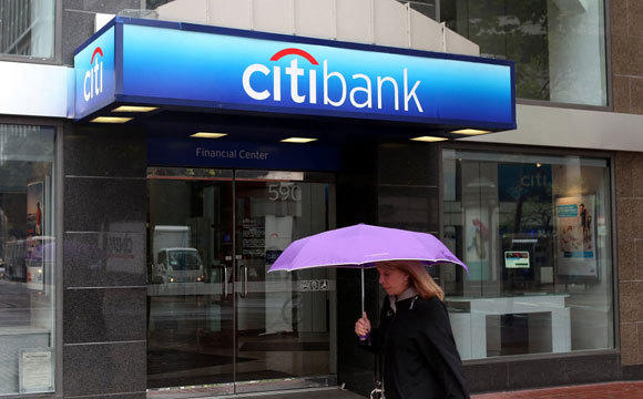 A woman walks past a Citibank branch in San Francisco in a 2011 file photo.