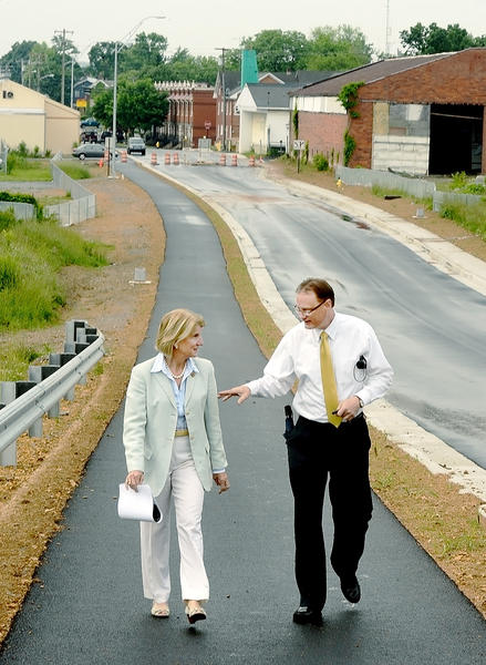 Rep. Shelley Moore Capito and Martinsburg City Manager Mark Baldwin walk on a bike path next to the southern part of the Raleigh Street extension in Martinsburg, W.Va. on Tuesday.
