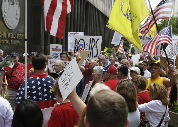 Tea party activists demonstrate outside the John Weld Peck Federal Building in Cincinnati. The building houses the main offices for the Internal Revenue Service in the city and is tied to the targeting of conservative groups.