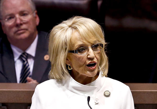 Arizona Gov. Jan Brewer is in federal court defending her 2012 executive order denying driver's licenses to young immigrants who have been granted temporary protection from deportation by the Obama administration. Above. Brewer is seen giving her State of the State address in January.